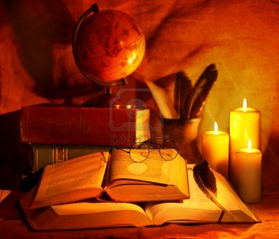 10217244-stack-old-book-and-candle-education